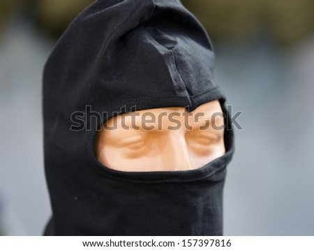 Mask for police forces on a doll - stock photo