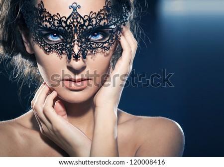 Mask.Nude.Girl.Venice carnival mask Close-up female portrait.Blue eyes. Black background - stock photo