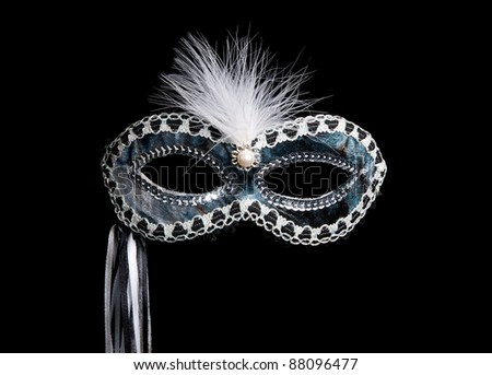 Mask on a black background - stock photo