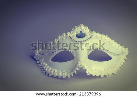 Mask on a gray background. Toned image - stock photo