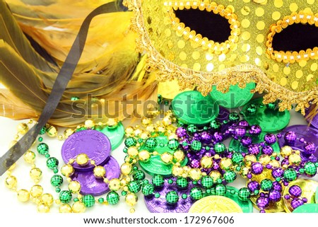 mask with beads and doubloons - stock photo