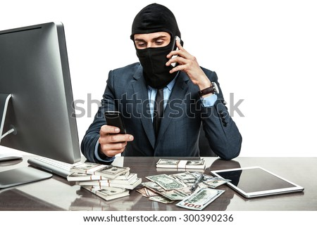 Masked anonymous businessman wearing balaclava helmet - stock photo