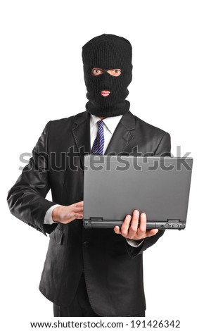 Masked businessman holding a laptop isolated on white background