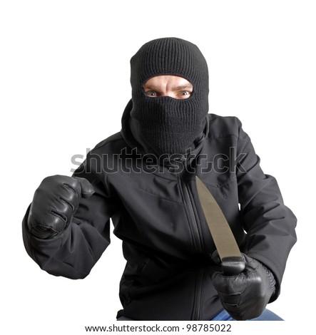 Masked criminal holding a knife, isolated on white - stock photo