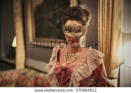 Masked girl at the party - stock photo