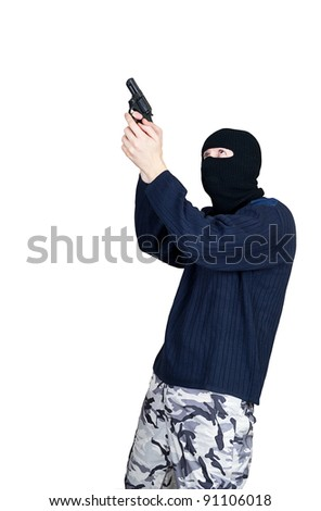 Masked man aims with gun - stock photo
