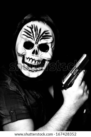 Masked robber with gun - stock photo