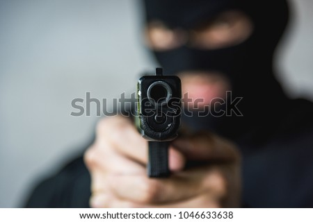 stock-photo-masked-robber-with-hand-gun-