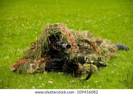 Masked shooter - stock photo