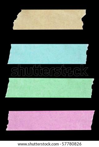 masking tapes close up isolated on black - stock photo