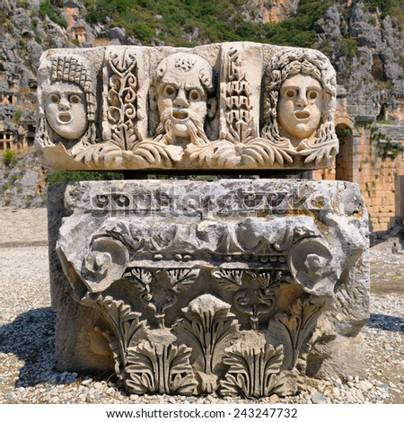 masks and Lycian tombs in the Myra, Turkey - stock photo