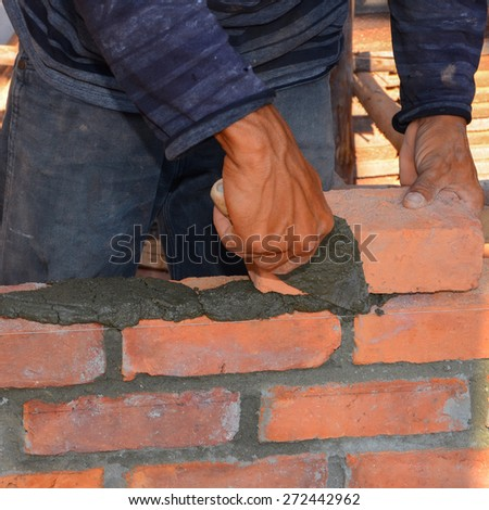 Mason brick walls were formed by using the work placement is patterned brick alternating rows up from the floor up. - stock photo