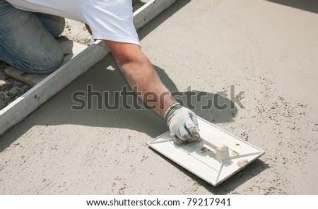 Mason building a screed coat cement - stock photo