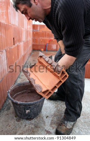 Mason hard at work - stock photo