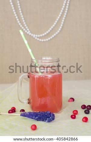 Mason jar party glass with flowers for spring birthday  - stock photo