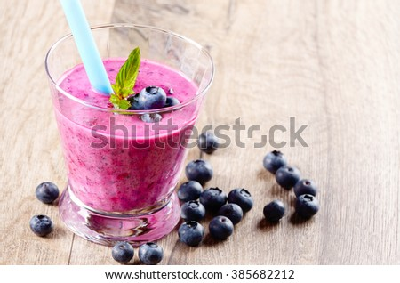 Mason jar with Blueberry shake on white table. Smoothie concept