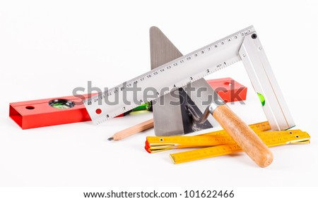mason tools and construction plans on white background - stock photo