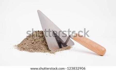 mason trowel and sand pile isolated on white - stock photo