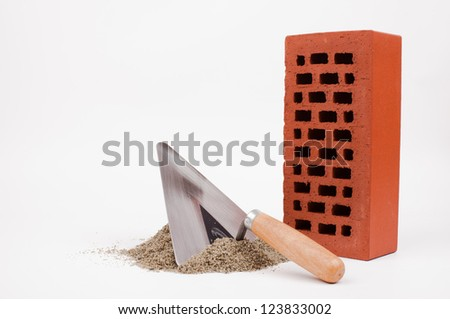 mason trowel, brick  and sand pile isolated on white - stock photo