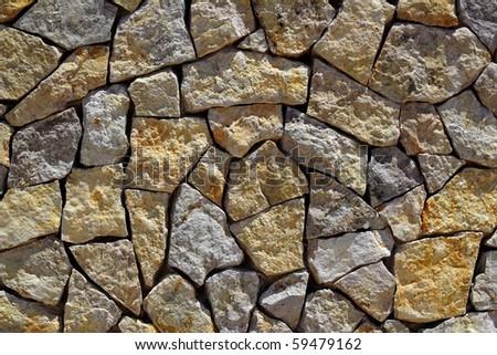 masonry stone wall rock construction pattern texture background - stock photo