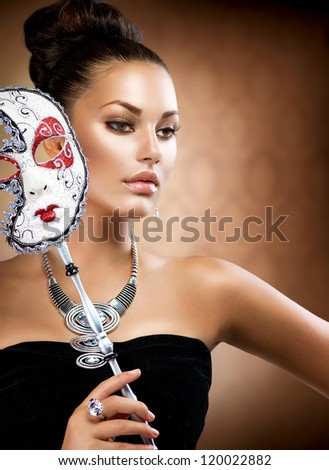 Masquerade Woman. Beauty Girl with Carnival Mask. Holiday Dress and Makeup. Fashion Brunette Portrait