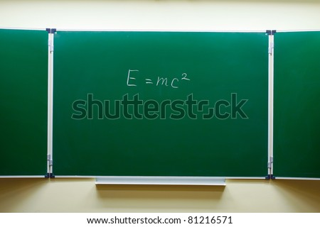 mass-energy equivalence formula on the blackboard - stock photo