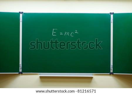 mass-energy equivalence formula on the blackboard - stock photo
