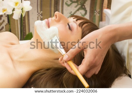 massage and facial peels at the salon cosmetics - stock photo