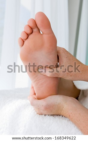 massage foot female  - stock photo
