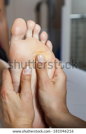 Massage foot female close-up - stock photo