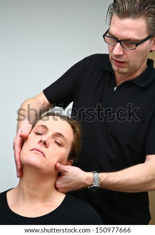 Massage in denmark in a chiropractise clinic (real situation) - stock photo