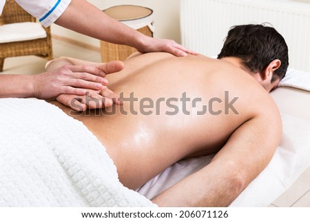 massage makes a man a woman in a beauty salon - stock photo