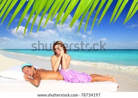 massage meditation shiatsu elbows pressure Caribbean beach woman [Photo Illustration] - stock photo
