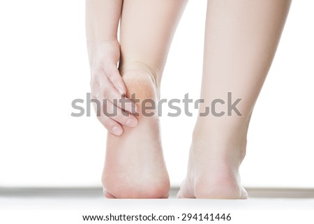 Massage of female feet. Pedicures. Isolated on white background. - stock photo