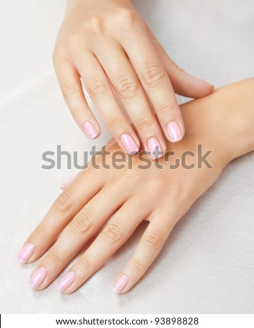 Massage of woman's hand on the white tablecloth - stock photo