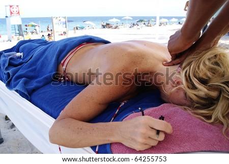 Massage on the Beach - stock photo