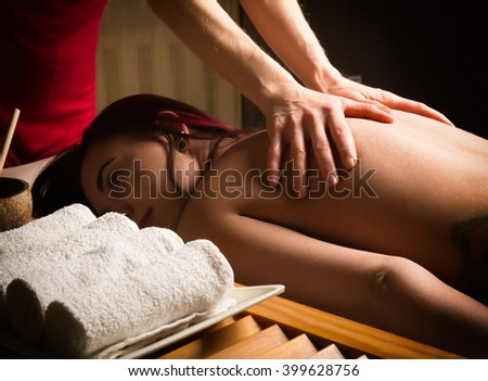 massage therapist at the spa salon makes cellulite massage to a patient. Beauty treatment concept - stock photo