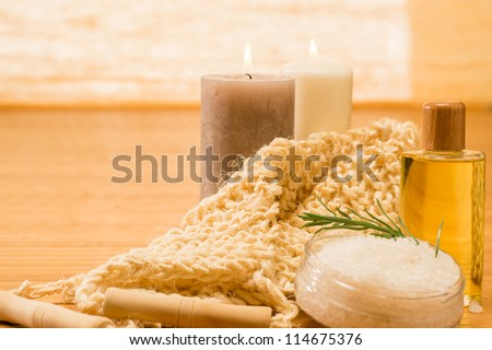 Massage treatment candles with oil scrub salt natural color - stock photo