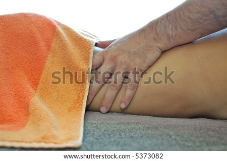 Massage treatment in spa center. - stock photo