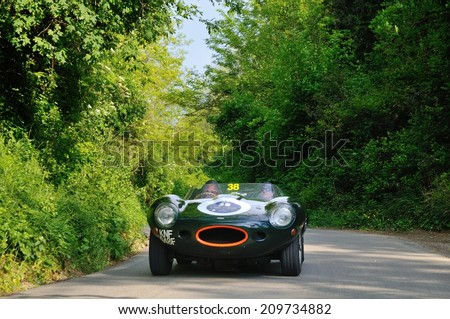 MASSAROSA, ITALY - APRIL 26: A green Jaguar D-Type takes part to the GP Terre di Canossa classic car race on April 26, 2014 near Massarosa. The car was built in 1957. - stock photo