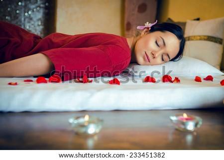 Masseur doing massage on woman body in the spa salon. - stock photo