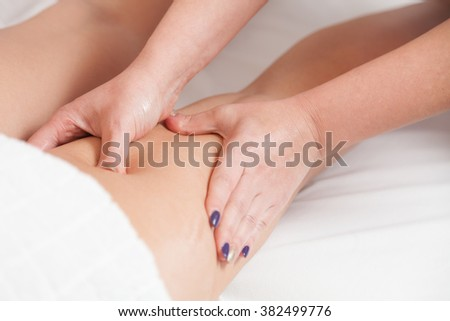 Masseur makes anti-cellulite massage young woman isolated on white background  - stock photo