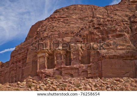 Massive carvings on the stone cliffs of ancient Petra, Jordan - stock photo