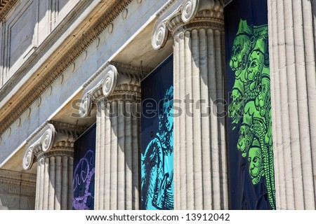 Massive columns and architectural style - stock photo