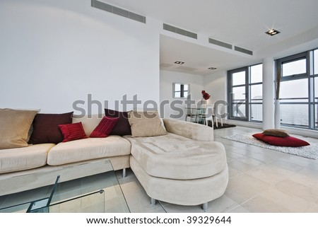massive penthouse living room  with L shaped sofa and dining area - stock photo