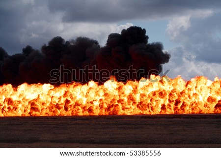 Massive wall of flame and destruction - stock photo