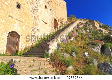 Massive walls and stairs of Palamidi fortress in the afternoon light, Nafplio, Greece - stock photo