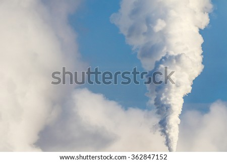 Massive white smokes going out of chimney. Air pollution - stock photo