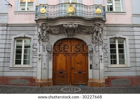 Massive wooden door to medieval mansion, Freiburg, Germany - stock photo
