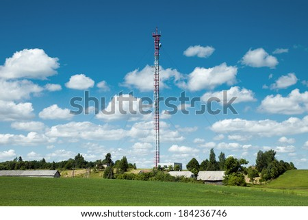Mast with several mobile network transmitters for GSM coverage and 3G/4G data transfer - stock photo